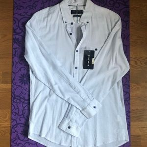 Classic white shirt with contrast buttons